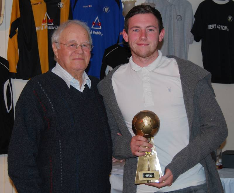 Jack Langston picks up the Supporters' Player of the Year award from Gilbert Egerton (Click to enlarge)