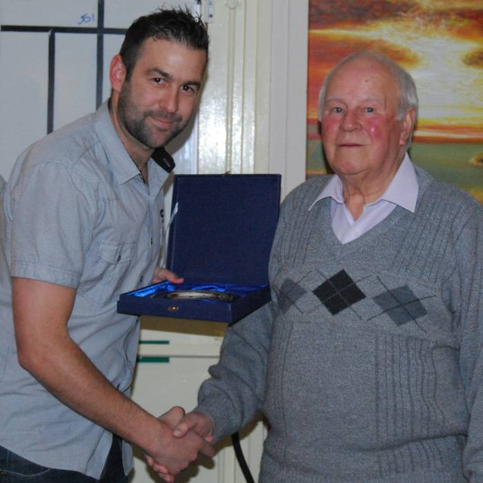 Carl Allen receives a momento from Gilbert Egerton tomark 300 appearances