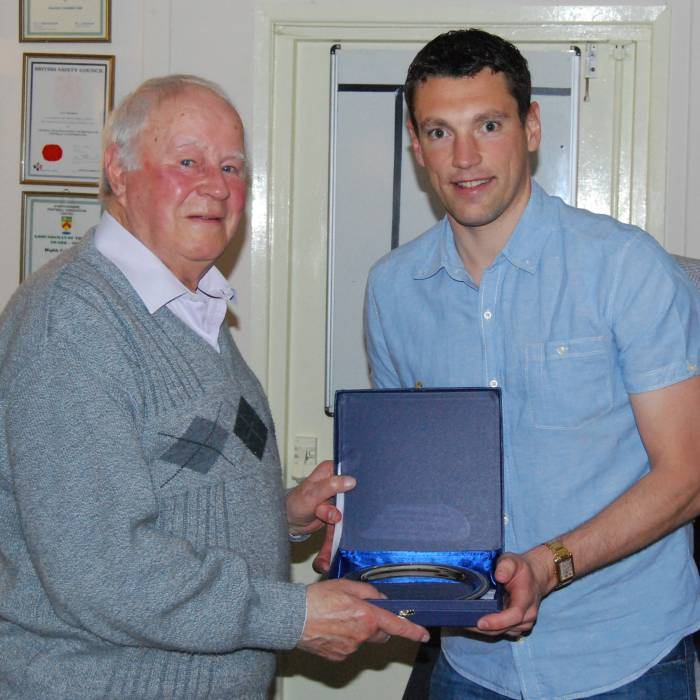 Richard Froggatt receives a momento from Gilbert Egerton tomark 350 appearances