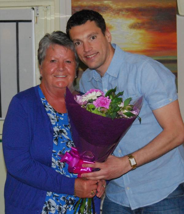 Helen Owen receives flowers from Richard Froggatt
