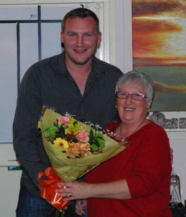 Janet Gregory receives flowers from Andrew Mottershead