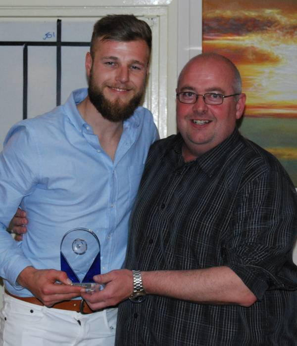 Tom Land receives Supporters POY from Martin Bloor