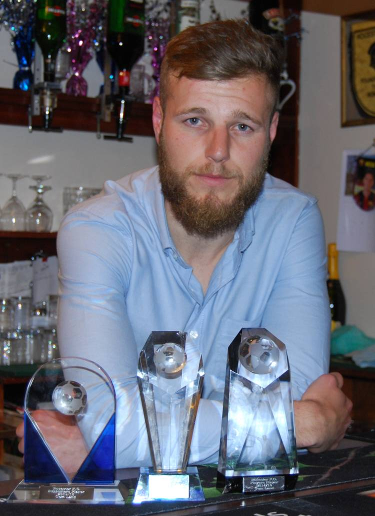 Tom Land with his three awards.