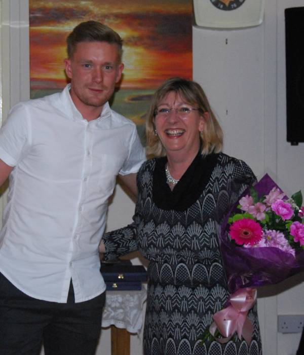 Vicky Burman receives flowers from Rob Ritchie-Smith
